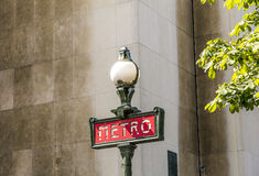 Parisian metro sign with a lamppost against  vintage wall Stock Images