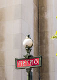 Parisian metro sign with a lamppost against  vintage wall Stock Photography