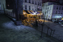 Parisian montmartre cafe at night. A classic Parisian cafe at night in Montmartre Royalty Free Stock Image