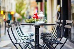 Parisian outdoor cafe decorated for Christmas Stock Photos