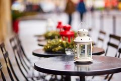 Parisian outdoor cafe decorated for Christmas Stock Images