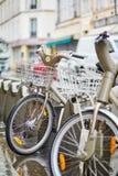 Parisian public bicycles under rain Stock Photography