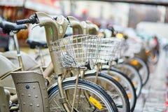Parisian public bicycles under rain Stock Images