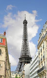 The Parisian street against Eiffel Tower in Paris. Royalty Free Stock Photos