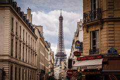 Parisian Street against Eiffel Tower in Paris, France Royalty Free Stock Images