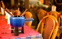 Parisian street cafe with a fondue pot Stock Image