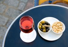Parisian street cafe table with aperitif Stock Photography