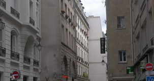 Parisian street with Hotel banner on the building stock video