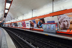 Parisian subway station with few passengers Royalty Free Stock Photography