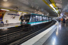 Parisian subway station with moving train Stock Images