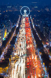 Parisian Taxi Cabs and Lights at the Champs Elysees in Paris, France. The world-famous avenue Champs Elysees seen glistening with lights at night with iconic royalty free stock image