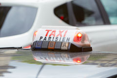 Parisian taxi sign in Paris Royalty Free Stock Photo