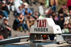 Parisian taxi Stock Images