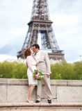 Parisian wedding. Happy married couple near the Eiffel Tower Stock Photography
