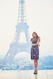 Parisian woman near the Eiffel tower at morning Stock Image