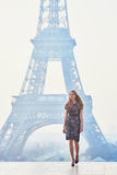 Parisian woman near the Eiffel tower at morning. Beautiful elegant Parisian woman near the Eiffel tower at early morning Royalty Free Stock Photography