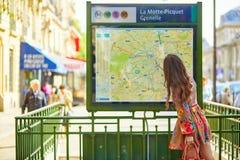 Parisian woman near the subway plan Royalty Free Stock Images
