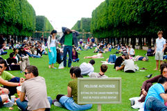 Parisians enjoying the grass at Luxembourg Gardens Stock Photo