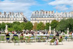 Parisians relaxing at the Tuileries Garden on a beautiful summer day in Paris Stock Photo