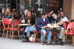 Parisians and tourist enjoy eat and drinks in Royalty Free Stock Photography
