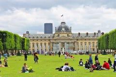 Parisians and tourists on lawn Champs de Mars Stock Photos