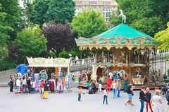 Parisians and tourists near the carousel on Montmartre. Royalty Free Stock Photo