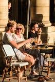 Parisians and tourists sit on the terrace of Le Nemours cafe. Pa. Paris, France - June 25, 2017: Parisians and tourists sit on the terrace of Le Nemours cafe in Royalty Free Stock Photos