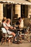 Parisians and tourists sit on the terrace of Le Nemours cafe. Pa. Paris, France - June 25, 2017: Parisians and tourists sit on the terrace of Le Nemours cafe in Royalty Free Stock Photography