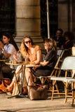 Parisians and tourists sit on the terrace of Le Nemours cafe. Pa. Paris, France - June 25, 2017: Parisians and tourists sit on the terrace of Le Nemours cafe in Stock Photos