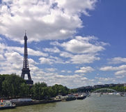 Eiffel Tour. Summer view of Paris from one of its many bridges on the Seine river royalty free stock image