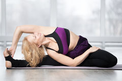 Parivritta Janu Sirsasana pose Stock Images