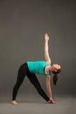 Parivritta-trikonasana yoga. Beautiful woman doing yoga on the background Royalty Free Stock Photo