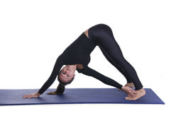 Parivrtta adho mukha shvanasana Stock Photos