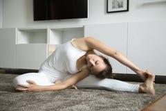 yoga indoors parivrtta janu sirsasana stock image  image