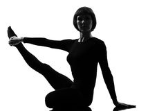 Parivrtta Krounchasana heron pose yoga woman Stock Photos