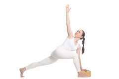 Parivrtta Parsvakonasana for beginning yoga student Royalty Free Stock Photography