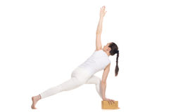 Parivrtta Parsvakonasana with wood brick Royalty Free Stock Photos