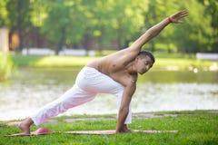 Parivrtta Parsvakonasana yoga Pose Stock Image