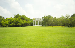 Park. Pavilion in the park with green grass Royalty Free Stock Photos