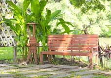 Park. Wooden park bench in the garden Stock Images
