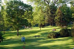 Park. Landscape - People on green grass lawn in park Stock Photo