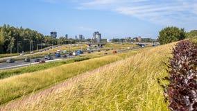 Urban motorway landscape Netherlands. Park adjecent to motorway A4 in Ypenburg the Hague, Netherlands stock photos