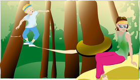 Park adventure. Boy walking on the rope in adventure park Royalty Free Stock Photo