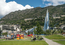 Park of Andorra. With commercial buildings in the background are the Pyrenees on a cloudy day. It is a imagen taken in September 2014. You can see some people Stock Photo