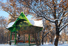 Park arbour in winter. Old green wooden park arbour in winter Stock Photography