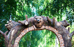 Park arc gate with bear head background. Hd Stock Image