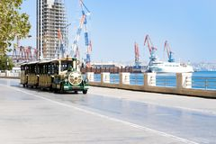 Park area. Beach side. fun train for child. Cargo ship in the Caspian Sea Baku, Azerbaijan. Image stock photography