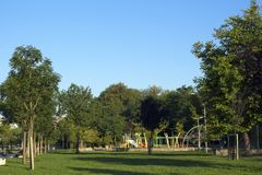 Park area with some activities. People are doing some exercise and plays on activity area when they have time. the park can use for as a background photo Royalty Free Stock Photos