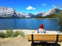 Woman at the Lake  - Peter Lougheed Provincial Park, Kananaskis Country , Alberta, Canada stock photography