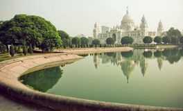Park around the Victoria Memorial Hall in Kolkata. Water in lake near the Memorial, historical palace in India royalty free stock images
